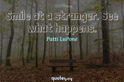 Photo Quote of Smile at a stranger. See what happens.