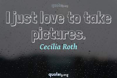 Photo Quote of I just love to take pictures.